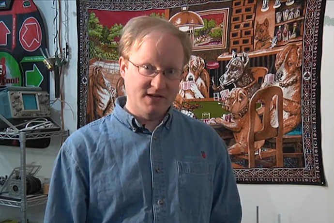 Ben Heck in front of Dogs Playing Poker Mural